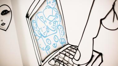 Ein Finger tippt auf eine Tastatur