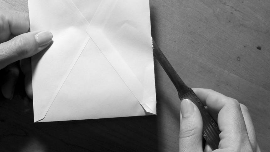 Brieföffner mit Briefumschlag