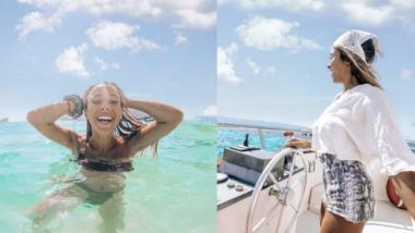 Frau posiert vor und im Wasser vor blauem Himmel mit Wolken
