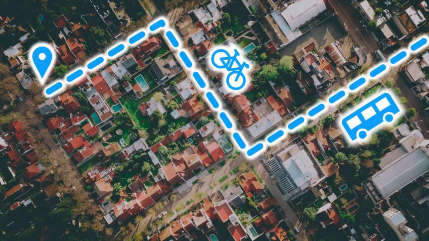 Häuser aus der Vogelperspektive mit eingezeichneter Route und Symbolen für Fahrrad und Bus