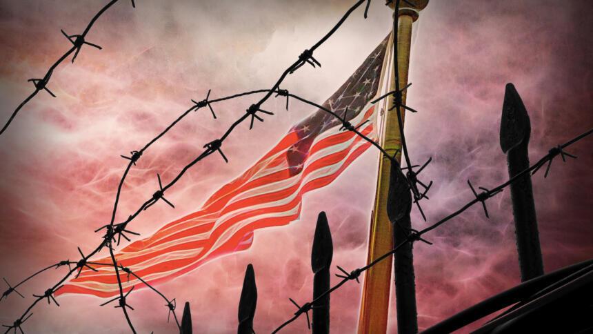 USA Fahne hinter Stacheldraht
