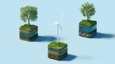 Eine Illustration mit Erdklötzchen, auf denen zwei Bäume und ein Windrad stehen.