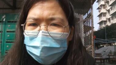 Zhang Zhan mit Maske