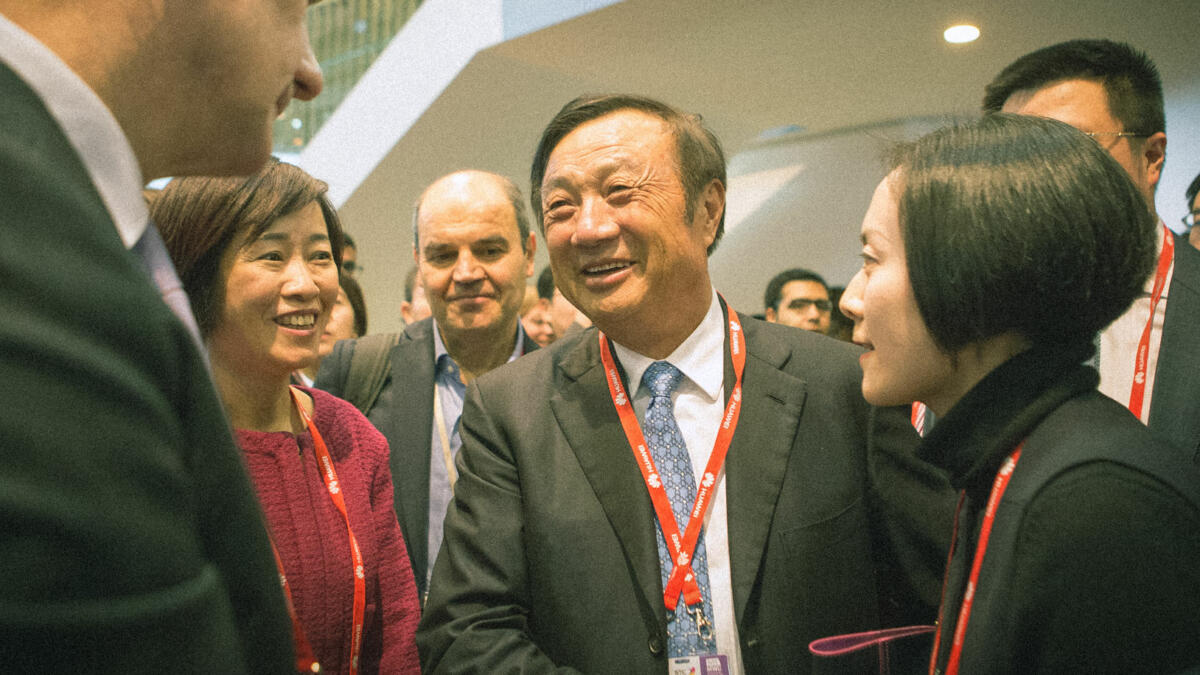 Huawei founder Ren Zhengfei (centre) likes to resort to military metaphors to motivate his employees