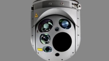 Das Bild zeigt ein halbkugelförmiges graues Gerät, an dessen Vorderseite sich fünf Öffnungen für Kameras und andere Sensoren befinden.